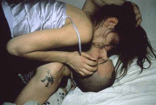 """Nan Goldin is an example of an artist who works at the most intimate level: her life is her work and her work, her life. It is nearly impossible to discuss Goldin's photographs without referring to their subjects by name, as though the people pictured were one's own family and friends. It is this intimate and raw style for which Goldin has become internationally renowned. Her ""snapshot""-esque images of her friends — drag queens, drug addicts, lovers and family — are intense, searing portraits that, together, make a document of Goldin's life.""  nan rules."
