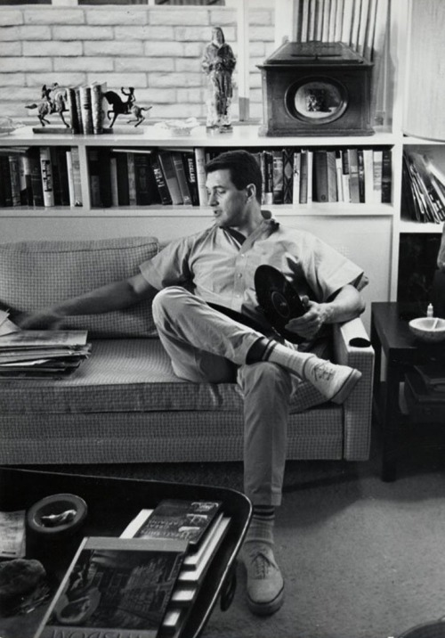 theniftyfifties:  Rock Hudson listening to records. Photo by Leo Fuchs