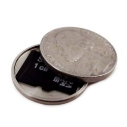 theworstthingsforsale:  This is a hollowed-out nickel which holds a microSD card. It's a really covert and easy way to accidentally put 2GB of sensitive data into a parking meter.