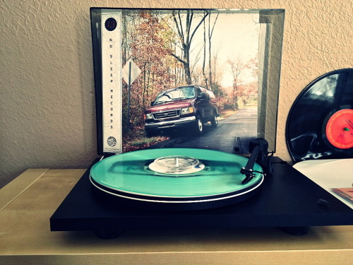 1recordaday:  The Wonder Years - Sleeping On Trash (coke bottle clear /200) [No Sleep Records Subscription]  So this is my test run, the record came in fairly warped but I was able to get a few tracks in, so hopefully No Sleep sends me a replacement. ANYWAY, I am stoked that all of these OOP 7-inches got pressed on 1 LP. its awesome for fans who don't have any of them, and love the format.    The few tracks I was able to spin are a of far superior sound than the 7 inches. I have no clue if these were remastered, but they sure sound like it, compared to the older pressings. I almost wish this came with some sort of insert, but alas, it did not. the gatefold is a very nice touch though.