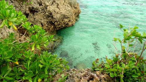 turquiose waters and rock formations at the Magpupungko Beach, Pilar, SIargao, Philippines