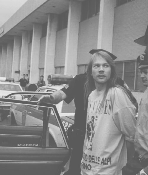 guns-n-fuckin-roses:  Axl being arrested at  Kennedy Airport, 1992