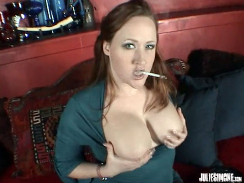 juliesimonesworld:  Screen grab, Redhead Julie Simone smokes a Virginia Slims 120s cigarette in a casual outfit. She quickly pulls out her fat tits and bounces them for you while she smokes.  She also squeezes them and rubs them.  Shot by Zenova Braeden Buy the clip at www.clips4sale.com/studio/9861 or get ALL My clips for one low price www.JulieSimone.com