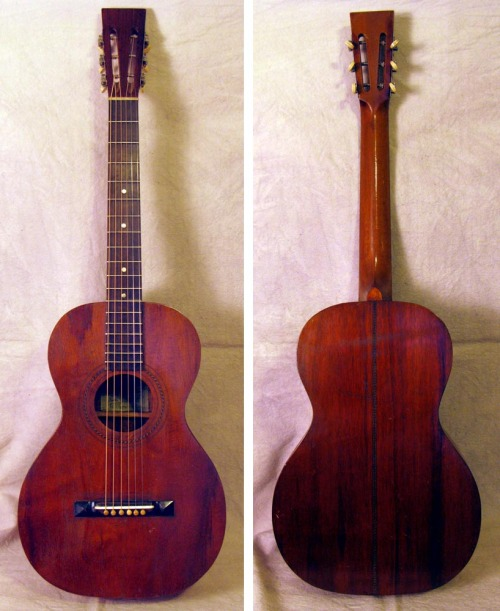 "Oscar Schmidt Hawaiian Guitar, 1920sStandard size, all solid Hawaiian koa wood. Original green paper label reads: ""Hawaiian Guitar by Oscar Schmidt"". Set up for Spanish style playing with recent neck reset. Several cleated top cracks. All original finish with no over-spray. Stella Guitars & Other Oscar Schmidt Instruments"