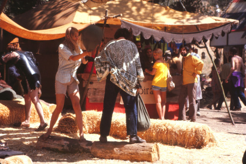 "RENAISSANCE PLEASURE FAIRE - VARIOUS PLACES IN CALIFORNIA Begun in 1963 in Agoura, near Malibu, to create ""living history"" for schoolchildren and their families, the Original Renaissance Pleasure Faire has grown into an annual interactive playground and gallery for over 200,000 participants and guests. It has given birth to an industry nationwide and this year is more fun and exciting than ever. This Southern California Faire has traveled a bit since Agoura. The Glen Helen Pavilion provided two different settings in Devore (in San Bernadino County) where the Faire spent many years. Shortly after the turn of the Century, the Faire moved back to Los Angeles County, to its current home at the Santa Fe Dam Recreation Area, a United States Army Corps of Engineers' Facility and a unit of County of Los Angeles Department of Parks and Recreation System in Irwindale, CA. Since its inception, more than 5 million people from around the world have visited Southern California's Renaissance Pleasure Faire, averaging approximately 20,000 each weekend. —The Original Renaissance Faire website Guide Note: All photos taken from the 1970 event that took place in Agoura Hills. You can see 44 different Kodachrome photos in my collection right here. * * *   Jordan Smith is the guide to ephemeral America for The American Guide. He currently works for the University of Notre Dame during the day and scans at night. He lives in South Bend, Indiana and you can find him on Flickr, his blog, or one of several Tumblr sites, including colortransparency.tumblr.com."