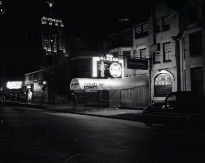 "Club Alabam, 747 N Rush, 1947, Chicago. ""Always 68 degrees and a 9 course deluxe dinner for $1.00."" The Palmolive Building and it's Lindbergh beacon is in the background."