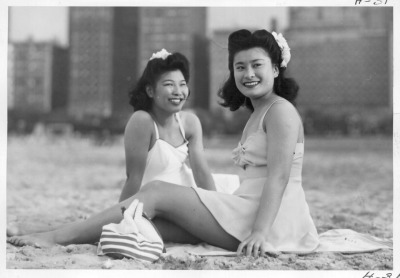 "Japanese Americans who had been ""relocated"" to Chicago during WW 2, enjoy a day at Oak Street Beach, 1949."
