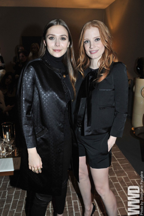 womensweardaily:   Elizabeth Olsen and Jessica Chastain Front Row at Louis Vuitton