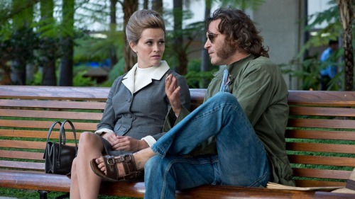 """Official Still of Reese Witherspoon and Joaquin Phoenix in Paul Thomas Anderson's """"Inherent Vice"""""""