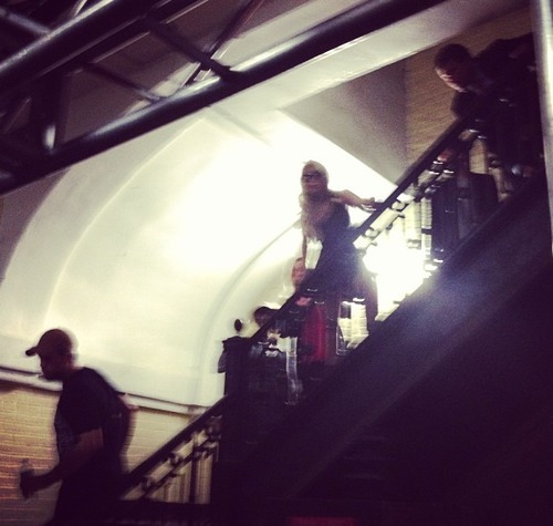 "A blurry photo of Gaga at the Versace show tonight.   Unfortunately Gaga has imposed a ""no video or photo"" rule and will not be allowing anyone to film while her music is playing. We don't know why. Wait, yes we do, it's because it's Gaga."