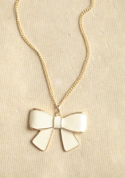 A darling bow necklace is the perfect little addition to any outfit.