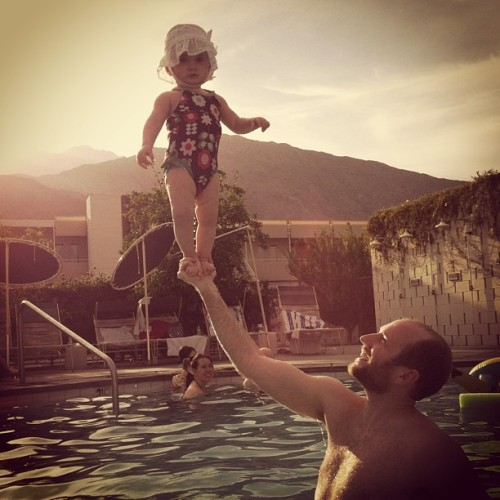 Claire perched on her dad, Aaron's, praiseful paw at Ace Hotel & Swim Club in Palm Springs.