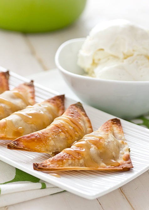 ingredients Baked Banana Wontons 1 medium banana, mashed with a fork 1/8 tsp. ground cinnamon 16 wonton wrappers (see note) 1 tsp. coconut oil, melted (or oil mister/cooking spray) Coconut Caramel Sauce 1/3 c. coconut milk (not light—you need the full-fat kind) 1/2 tsp. vanilla pinch of salt 1/4 c. sugar 2 tbsp. water instructions Baked Banana Wontons Preheat oven to 400 degrees. Combine cinnamon and banana in a small bowl. Place a heaping teaspoon of banana filling in the center of each wonton wrapper. Brush edges of wrapper with a small amount of water, fold into a triangle, and press edges together to seal. Brush both sides of each finished wonton with coconut oil (or spray both sides with oil or cooking spray). Place wontons on a baking sheet. Bake for 8-10 minutes or until corners are browned and crispy. Coconut Caramel Sauce  Whisk together coconut milk, vanilla, and salt in a small bowl. Set aside. Combine sugar and water in a small heavy-duty saucepan over medium-high heat. Do not stir! Allow mixture to come to a boil. Once it begins to boil, watch it like a hawk. Eventually the mixture will start to smell like caramel and turn a golden color, then light brown. This will take about 6 minutes. When you see that it's started to turn brown, slowly pour in coconut milk mixture, whisking constantly and quickly. If the sugar hardens around the whisk, don't worry; it will melt. Just keep whisking! Continue to heat over medium-high until mixture has thickened and is a light caramel color, about 5 minutes more. Drizzle over wontons and ice cream.