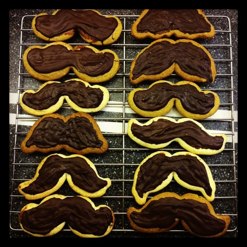 Christmas mustache cookies! Gingerbread + sugar cokies you must need a mustache shaped cookie cutter though! makes 100 cookies in TOTAL Sugar Cookie Recipe  170g butter softened  200g sugar 2 eggs 1/2 tsp vanilla 310g flour 1/2 teaspoon baking powder Beat butter with sugar until smooth, add egg and vanilla, beat. Stir in flour, baking powder. Form into dough, if too sticky add more flour until it's firm enough to wrap into dough. Chill 1 hour. 200C. Roll it out, cut into shapes. Put on pan with baking paper Bake 6 minutes. Gingerbread Cookie Recipe 200 g flour 200g butter softened 240g sugar 4 eggs 4tsp ginger 2tsp: nutmeg, cloves, cinnamon Beat butter and sugar until smooth, add eggs, mix in flour and all the spices. Form into dough. If sticky, add flour until it's not. Chill 1 hr. 180C. Roll out, cut shapes. Put on baking sheet on pan. Bake for 5 minutes For mustache cookies: I melted dark chocolate and just spread it on. But you could always use royal icing and decorate if you want. Royal icing:\ 3 whites 1/2tsp cream of tartar 480g icing sugar food colouring Beat whites with cream of tartar, then add icing sugar, beat until its really thick and really white. Test if its ready by using a spoon and taking a bit of the icinga nd putting it on a paper towel and refrigerating it, if it sets and hardens in 30 minutes, then its ready, if it still wont set, continue adding icing sugar until it does. Decorate!