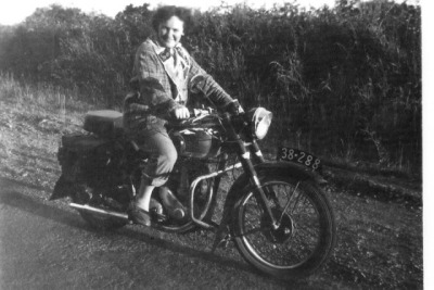 "A little flash back from a motolady in Australia.  ""My husband's 1951 BSA B31 350cc which I learned to ride on briefly during 1956…….no licence then. Didn't start again until 7 years ago and got my licences then. That is me on it! I now ride a 1200cc Custom HD in Aussie — a Bulls, New Zealand"" (Monique W. Petersen)"