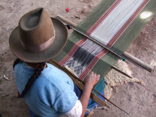 madamecuriewasmymother:  A young lady weaving an Alpaca scarf in Peru by Lisette Verkerk