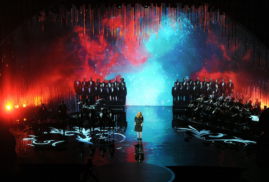 nparts:  Adele performs the theme to Skyfall onstage during the Oscars Sunday. (Photo by Kevin Winter/Getty Images)