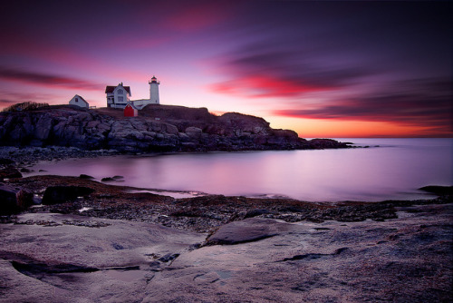 neptunesbounty:  Nubble Light - Low Tide Sunrise by Jeff Bazinet on Flickr.