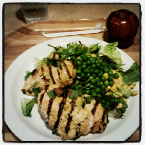 #Lunch today. 2 Malaysian grilled chicken breasts over a bed of greens lettuce (romaine lettuce, Arugula, peas, corn). The apple is my snack for later. #food #foodie #foodporn #health #healthy #fit #fitness #cleaneats #eatcleantrainmean