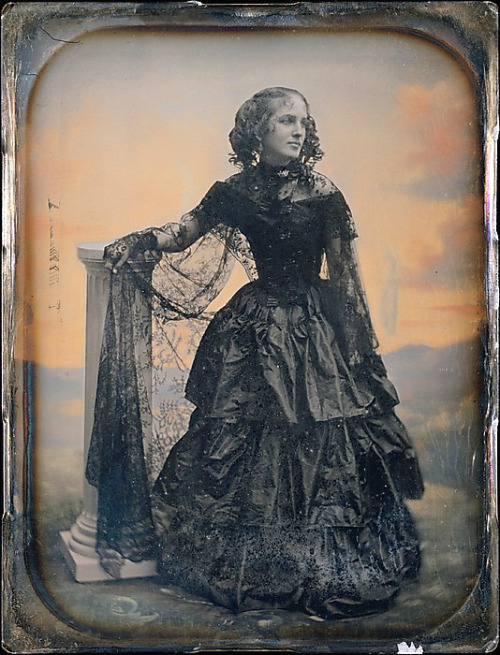 thecivilwarparlor:  Woman in Black Taffeta Dress and Lace Shawl-Pre-Civil War  Women's dress in to the Civil War, Women loved the idea of a tiny waist with yards of material in the skirt. The corset was being worn along with a metal hoop and crinoline to make the desired effect of a tiny waist with a huge skirt. Albert Sands Southworth  (American, West Fairlee, Vermont 1811–1894 Charlestown, Massachusetts)