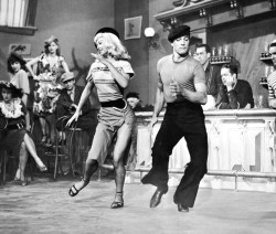 theniftyfifties:  Gene Kelly and Vera Ellen hoofing it in 'Slaughter on Tenth Avenue', 1957.