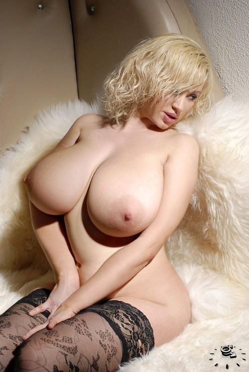 bigboobhugeass:  Awesome busty blonde MILF with her huge milky tits ready for sucking and pressing