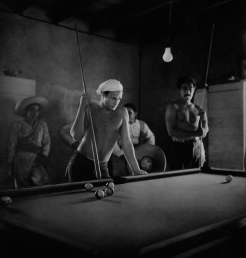 wehadfacesthen:  Marlon Brando and Anthony Quinn playing pool during a break from filming Viva Zapata!, Texas, 1951, photo by Sam Shaw