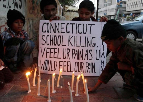 imranalimalik:  Kids in Karachi light candles in a vigil for the victims of the Connecticut School shooting. Poetic.