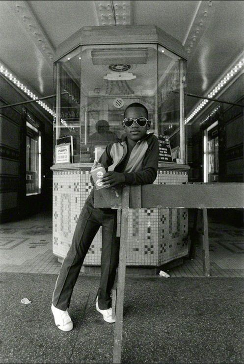 Dawoud Bey - A Boy in Front of the Loews 125th Street, 1976