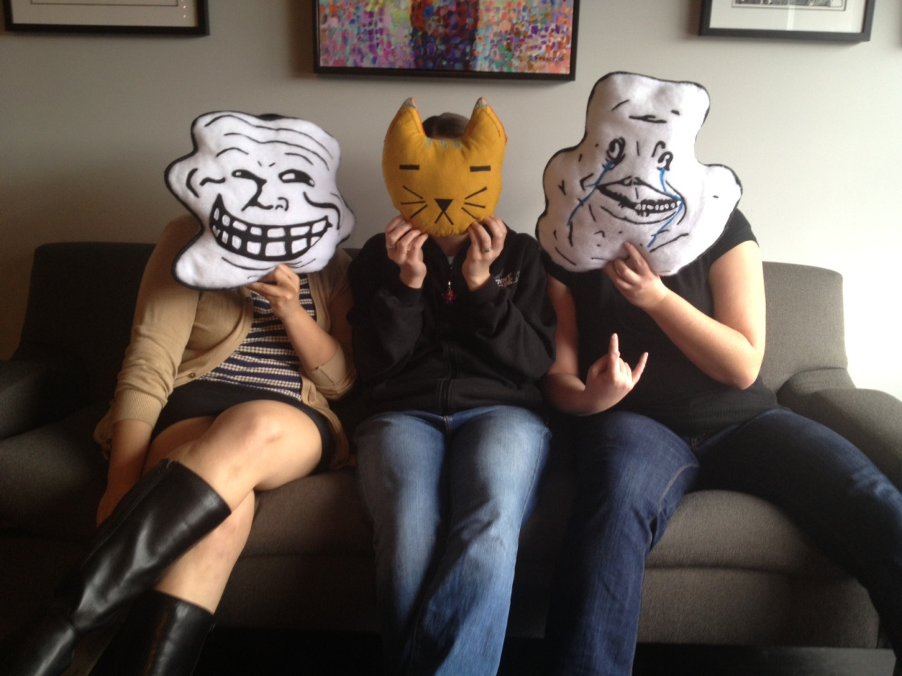 Kristin, Beth, and Aneta show off some of our office decor from awesome Tumblr users!  The Troll and Forever Alone pillows come from DerpShop, and the cat pillow is from Whitney, owner of Fill It with Diamonds. Thanks for making our office pillows awesome, guys!