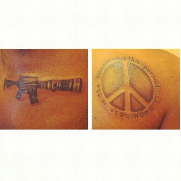 "My Bday presents to myself: CameraGun- ""Make movies not war"" Peace sign/Quote ""The pursuit of happiness is the happiness in the pursuit"" Also my first tat's with White Ink…"