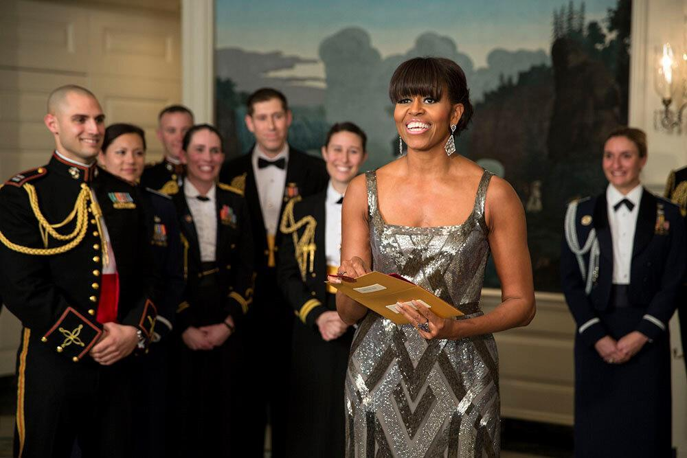 Michelle Obama, in Naeem Kahn, announces the winner of Best Picture of the 85th Academy Awards. Photo by official White House photographer Pete Souza.