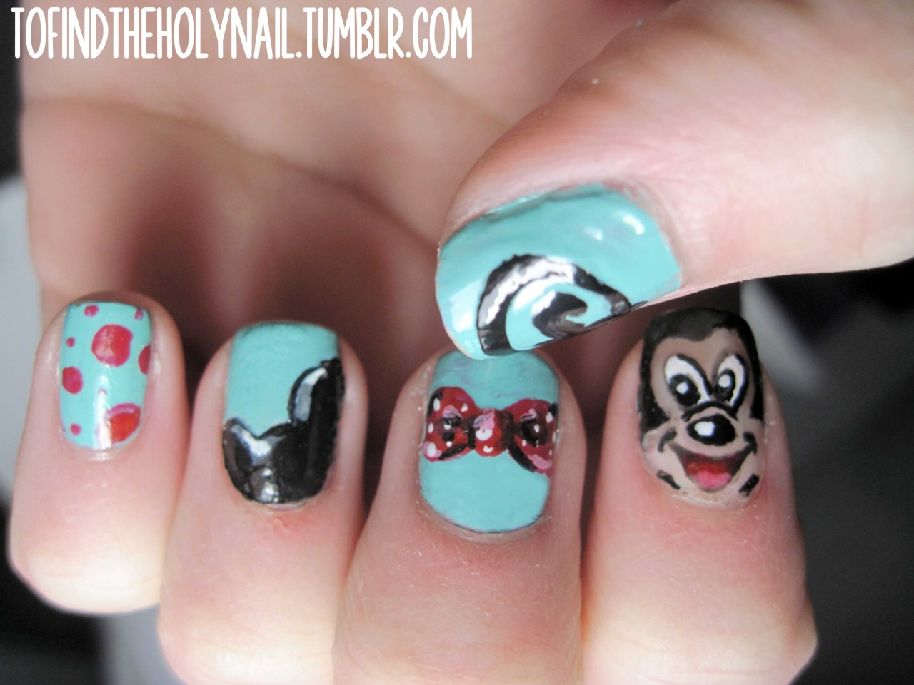 Mickey mouse nails! These were lots of fun to paint.I used For Audrey, Scarlet, and Nude (all by China Glaze), Blanc (by Essie), and Black Out (by Sally Hansen).