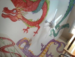 The Dragon Room. These crazy Chinese dragons are painted on the ceiling of a boy's room in Denver. The walls are beige with a few clumps of bamboo painted on them.