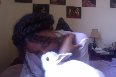 Sorry for spamming you with pictures of my ugly face and my adorable rabbit, but LOOK AT THIS ADORABLE LITTLE FUZZBUTT GIVING ME BUNNY KISSES, OKAY.