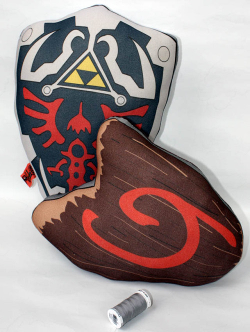 squidsquiddly:  Take a look at the new Legend Of Zelda inspired pillows in our shop! But, seriously, who DOESN'T need a soft, squishy Hylian shield to brighten up their couch or bed? https://www.etsy.com/listing/151206614/hylian-sheild-inspired-pillow