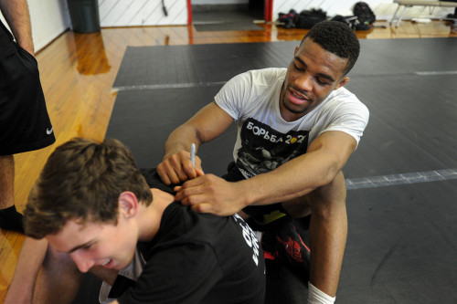 Jordan Burroughs signs a shirt for Patrick Halkett following practice at Harvard-Westlake High School Pic mng-lang
