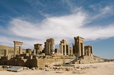Apadana Palace (Persepolis, Iran) Built by Darius the Great around 515 B.C., the palace must have been a wonder to behold. Massive columns—of which thirteen remained standing by the twentieth century—supported the roof. The staircases were embellished with rows of reliefs that displayed successions of delegates, soldiers, guards, and chariots carrying presents and offerings to honor the king. The front walls of the palace were carved with images of the Immortals of 300 fame—the Persian Kings' noble guard.