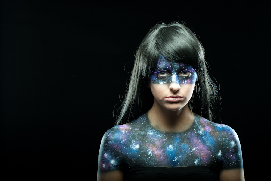 This makeup was done by me for a friends ad campaign for Black Milk Clothing's Galaxy Purple leggings. I used Skin Illustrator's liquid airbrush makeup for the black base, and the blue undertones. The lighter blues, pinks, purples, and oranges were acrylic paint that was very lightly sponged on. And to tie it all together I put on each star, one by one.