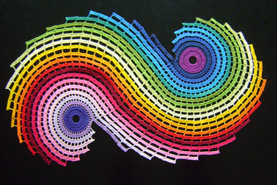 This mind-bending crocheted rainbow fractal was posted by ColoridoEclectico and based on a table runner pattern on Ravelry.  (via MAKE | Crocheted Rainbow Fractal)