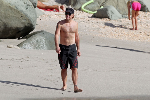 Looking good there Jon Bon Jovi! The 50-year-old rocker was spotted shirtless yesterday (January 03, 2013) as he enjoyed a day on the beach with wife Dorothea Hurley in St. Barts.  The rocker enjoyed a nap before walking down the beach and goofing around with friends. Clearly quite fit, Jon could be seen pretending to run away from his family as they gathered their stuff from the day on the sand. Earlier that day, Jon was spotted taking a run in a tank top and green shorts to keep in shape for his grueling but, entertaining concert performances. A few days prior, he took a stroll along the beach with his family.  It was a rough end to the year for the Bon Jovi family, with his daughter Stephanie's drug issues, but he definitely seems as if things are on the mend.