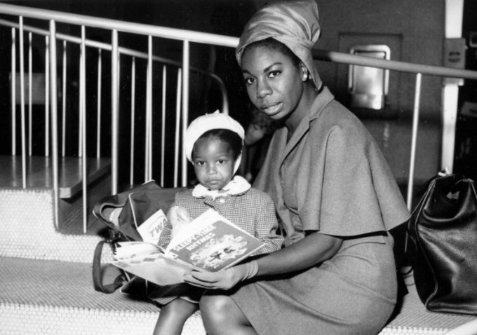 Nina Simone reads to her daughter.