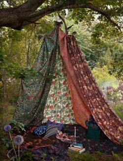 a fabric tent in the woods via x.
