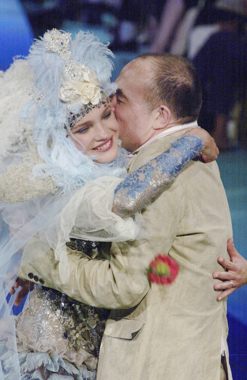 Natalia Vodianova and Christian Lacroix embrace during the finale of his Fall 2003 Haute Couture show