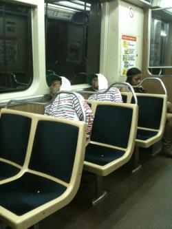 dayinthelifeofchris:   There are two identical-looking people sleeping on the subway  Are you trying to say black people look the same!?  lol maybe their twins …