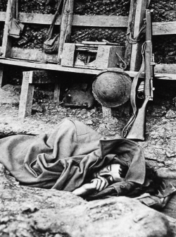 An Australian soldier lies asleep in a trench. Fleurbaix, 1916.Ernest Brooks