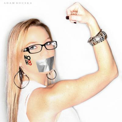Lauren Drain, a former member of the Westboro Baptist Church, poses for the NOH8 Campaign.  Via Gay Star news, Drain writes:  The main reason I posed for the NOH8 Campaign was in direct response to the judgments of the WBC. I wanted to show people that despite having grown up within the cult and having spent a good portion of my life on the picket line, holding signs condemning our deceased soldiers, reveling in any and all forms of tragedy and simply striving to be hurtful in the name of God; that the WBC is wrong and what I did at the time was wrong! I now try and lead by example, with love, compassion and an open mind. Having done a complete 180, I still struggle with little things from time to time – but I know in my heart that I am now on the right path. In the end, I think God will judge us all; however I think He wants us all to have the freedom to make our own decisions. Love, Lauren.  Related: Meghan Phelps explains her decision to leave Westboro Baptist Church