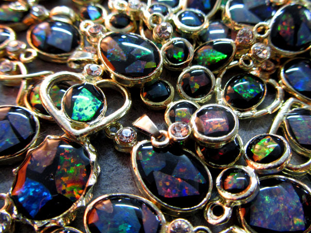 Opal chips  set in pendants-wild colours