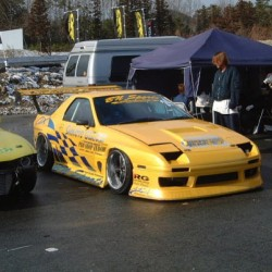 We have a thing for this #yellow #Mazda #FC3S #RX7. #326power #bnsports  #slammed #stance and ready for action! (at www.MOTORMAVENS.com)