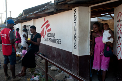 "Photo: Chatuley Hospital in Léogâne. Haiti 2012 © Emilie Régnier  Health Care Lags In Haiti's Post-Earthquake Rebuilding Efforts Three years after a massive earthquake battered the island nation of Haiti on January 12, 2010, the Haitian health care system remains mired in a state of devastation. Doctors Without Borders/Médecins Sans Frontières (MSF), which was present in the country before the earthquake and responded with its largest-ever emergency relief effort, continues to manage four hospitals that were built to replace temporary structures the organization set up immediately after the initial disaster, which destroyed most of the existing health structures in the impact zone. Tens of thousands of Haitians have received free, high-quality health care at these facilities, but it's unlikely that MSF will be able to hand over the management of these hospitals to Haitian authorities any time soon. ""The transition process is much too slow,"" says Joan Arnan, MSF's head of mission in Haiti. ""That's because Haitian institutions are weak, donors have not kept their promises, and the government and the international community have failed to set clear priorities."" The inadequate response to the recurrent cholera epidemic—the other catastrophe that first struck Haiti in 2010—signifies the delays in the recovery of the country's health system. For three years now, cholera has struck Haitians in unforgiving waves. In 2012 alone, MSF treated nearly 23,000 cholera victims in cholera treatment centers in Port-au-Prince and Léogâne. The number of cases increased after Hurricanes Isaac and Sandy hit Haiti last fall, causing sewers to overflow and spreading the bacteria that transmit the disease. The case numbers dropped somewhat last month, but MSF was still treating more than 500 cases each week. There are deep-rooted reasons for this, which have not yet been addressed. ""The majority of the population lacks access to drinking water and proper sanitation, but cholera treatment has still not been properly integrated into the few existing public health facilities,"" Arnan explains. In Léogâne, for example, approximately 30 kilometers [18 miles] from Port-au-Prince, several humanitarian organizations fighting the epidemic pulled out when they ran out of funding. This led to a rise in the number of patients admitted to MSF's treatment unit. The thing happened in Port-au-Prince, where MSF cholera treatment centers in the Delmas and Carrefour neighborhoods remain the only possibilities for patients and the number of patients has risen as other actors have closed their doors. Léogâne, the city closest to the earthquake's epicenter, was largely destroyed by the quake. Today, it resembles a huge construction zone. Most of the people who survived have found new housing, but the health sector has not rebounded as well. The MSF hospital is the only facility in the region offering free care available around the clock in case of emergency. MSF arrived in Léogâne just after the earthquake and set up a tent hospital to treat quake survivors. This temporary facility was replaced by a building made of shipping containers, which opened in September 2010. In addition to maternity care, the hospital treats medical emergencies and has a surgical unit. Most of the surgeries performed involve women who require Caesarean sections and victims of road accidents. Staff conducts consultations for pregnant women and children under five years of age in another building. There are, on average, 600 births each month at the facility, with peaks of more than 800. Other medical facilities regularly refer patients to the MSF hospital for treatments ranging from simple labor and delivery cases to complicated ones that require a Caesarean section and, thus, an operating room that functions 24 hours a day.  Although MSF's goal is to handover these activities to the Ministry of Public Health in Léogâne, the hospital is drawing increasing numbers of patients—some from as far away as Port-au-Prince—a clear indication of the profound lack of adequate care available. ""The hospital fills a gap that existed well before the earthquake,"" Arnan says. ""Most Haitians did not have access to medical care before January 12, 2010, whether this is because of the lack of available services or because they didn't have enough money. We came in response to the catastrophe and intended to stay until reconstruction could get underway and the public health facilities could take over. Unfortunately, it's been three years and almost nothing has changed in terms of access to care."""